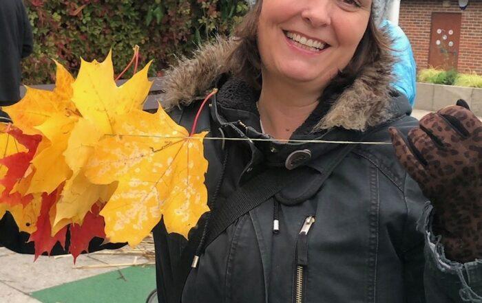 Volunteer collecting leaves